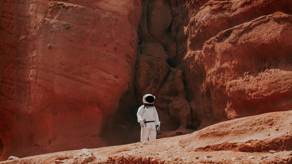 Space suit on rock
